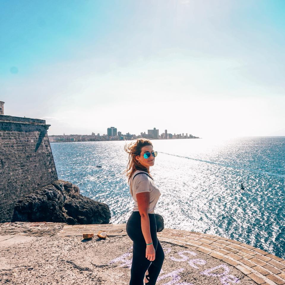 Woman standing at the Fort in Havana overlooking ocean